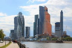 Panoramic view of the modern glass architectural complex Moscow city cloudy spring day Moscow Russia. Panoramic view of the beautiful modern glass architectural royalty free stock photos