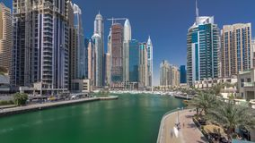 Panoramic view with modern skyscrapers and yachts of Dubai Marina timelapse hyperlapse, United Arab Emirates stock video