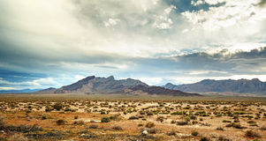 Panoramic view of the mojave desert. Under a cloudy sky Royalty Free Stock Photos