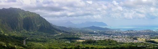Panoramic view of Monalula Ridge and Kaneohe town. Looking towards a distant Kualoa Ridge on Oahu, Hawaii on a cloudy day Royalty Free Stock Photography