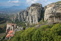 Panoramic view on four monasteries of Meteora, Greece royalty free stock image