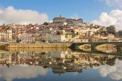 Panoramic view and Mondego river. Coimbra. Portugal. Panoramic view of the old town, the university building on top of the hill, and Mondego river. Coimbra Royalty Free Stock Photo