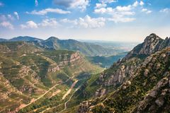 Panoramic view of Montserrat mountains, Catalonia, Spain. Aerial view of Montserrat mountains near Barcelona, Spain. Limestone rock formations Stock Photography
