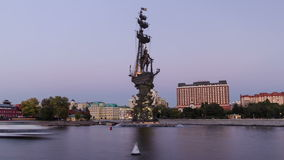 Panoramic view of the monument to Russian emperor. Peter the Great, on background of blue sky. Timelapse hyperlapse from day to night transition, Moscow, Russia stock video