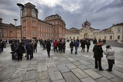 The Reggia di Venaria Reale declared World Heritage Site by UNESCO Panoramic view of monumental Royal Palace with crowd of tourist Royalty Free Stock Photos