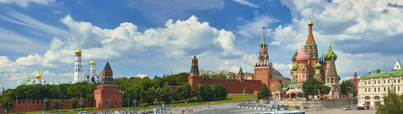 Panoramic view on Moscow Red Square, Kremlin towers, stars and Clock Kuranti, Saint Basil& x27;s Cathedral church Ivan bell tower. Stock Photo