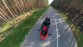 Panoramic view of the motorbike with the rider in motion. Motorcycle on a road. stock video footage