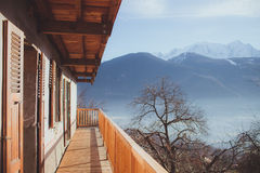Panoramic view from mountain chalet in the Alps of winter mounta. Panoramic view from balcony of traditional mountain chalet in the Alps of idyllic winter Stock Image