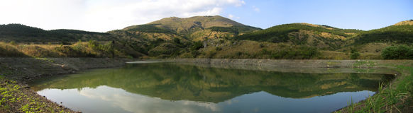 Panoramic view of mountain lake stock photography