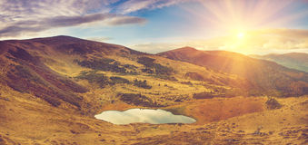 Panoramic View of mountain lake with sunlight. View of mountain lake with sunlight Stock Photos