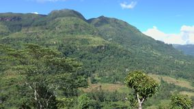 Panoramic view of the mountain landscape in a green valley with the villages. View of Puna Waterfall in Central Province, Sri Lanka stock footage