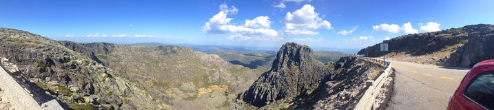 panoramic view of mountain landscape with Kantar Magra and red car on a streamer in the reserve of the Sierra de Eshtrella Stock Images