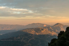 Panoramic view of mountain landscape on sunset. Last sun beams at the tops of the mountains near Monastery of Montserrat, Spain Stock Images