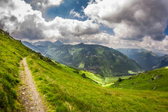Panoramic view of mountain peaks from the trail Royalty Free Stock Photo