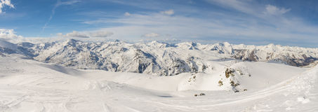 Panoramic view of mountain range with ski piste Stock Images