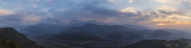 Panoramic view of a mountain ridge Annapurna. Royalty Free Stock Photography