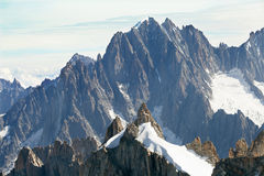 Panoramic view of mountain summits in French Alps. The panoramic view of mountain summits from view point at Aiguille du Midi Royalty Free Stock Image