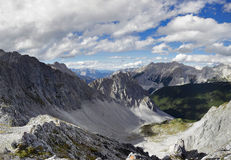 Panoramic view from a mountain top. The view from the top of a mountain in the alps Stock Photos