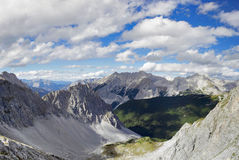 Panoramic view from a mountain top. The view from the top of a mountain in the alps Stock Images