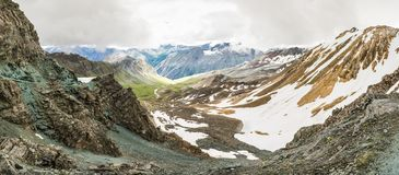 Panoramic view of a mountain valley from a ridge Royalty Free Stock Images