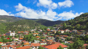 Panoramic view of mountain village with church Stock Image