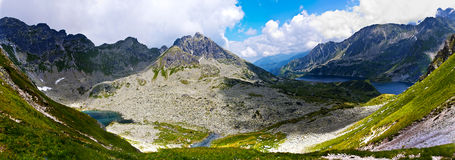 Panoramic view on mountains. Panoramic view to the valley from the summit stock photography
