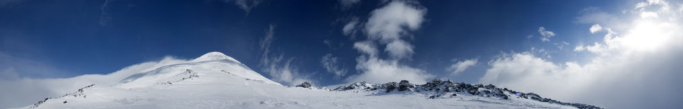 Panoramic view of the mountains. Panoramic view of the main Caucasian mountain ridge. View on Elbrus, 3500m Stock Photos