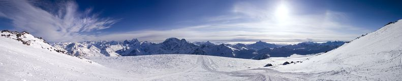 Panoramic view of the mountains. Panoramic view of the main Caucasian mountain ridge. View from Elbrus, 4100m Royalty Free Stock Photo