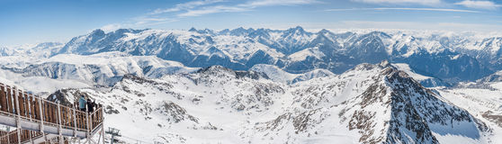 Panoramic view of the mountains. A panoramic view on Alps winter mountains, Les 2 Alpes, France Royalty Free Stock Images
