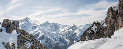 Panoramic view of the mountains. A panoramic view on Alps winter mountains, Les 2 Alpes, France Royalty Free Stock Image