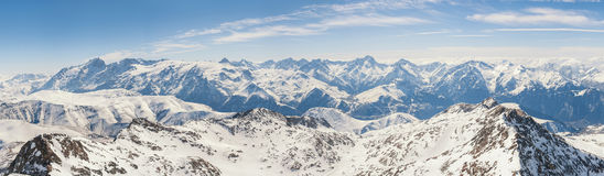 Panoramic view of the mountains. A panoramic view on Alps winter mountains, Les 2 Alpes, France Royalty Free Stock Photos