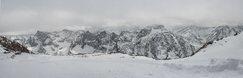 Panoramic view of the mountains. A panoramic view on Alps winter mountains, Les 2 Alpes, France Stock Photos