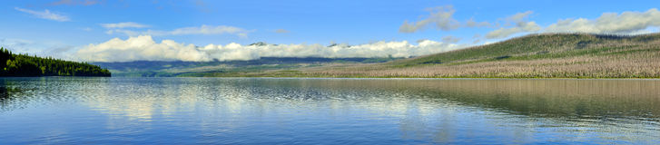 Panoramic view of the Mountains and McDonald lake in Glacier National Park Stock Photo