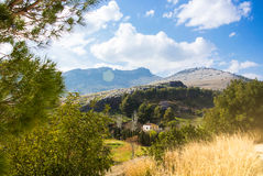 Panoramic view of mountains near Jaen, a little white house and pine forest Royalty Free Stock Image