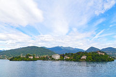 Panoramic view on mountains and towns on the Lake Maggiore in summer. Royalty Free Stock Photo