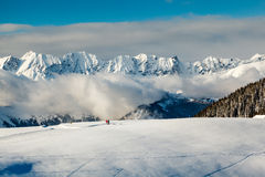 Panoramic View on Mountains and Two People Walking in French Alp Stock Images