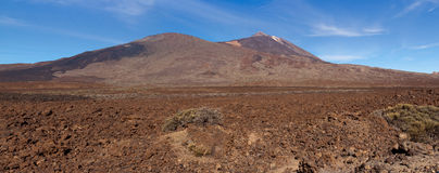 Panoramic view of Mt Teide in Tenerife. Panoramic view across the lava fields looking at the dormant Volcano Mt Teide royalty free stock image