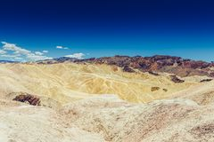 Panoramic view of mudstone and claystone badlands at Zabriskie Point. Death Valley National Park, California USA. Panoramic view of mudstone and claystone Royalty Free Stock Image