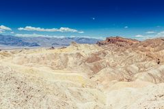 Panoramic view of mudstone and claystone badlands at Zabriskie Point. Death Valley National Park, California USA. Royalty Free Stock Photos