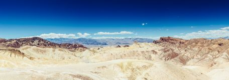Panoramic view of mudstone and claystone badlands at Zabriskie Point. Death Valley National Park, California USA. Panoramic view of mudstone and claystone Royalty Free Stock Photography