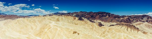 Panoramic view of mudstone and claystone badlands at Zabriskie Point. Death Valley National Park, California USA. Panoramic view of mudstone and claystone Stock Photo