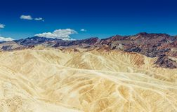 Panoramic view of mudstone and claystone badlands at Zabriskie Point. Death Valley National Park, California USA. Royalty Free Stock Photo