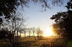 Stunning sunrise on the countryside on a frosty winterday in Holland stock photos