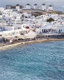 panoramic view of the Mykonos town harbor with famous windmills from the above hills on a sunny summer day, Mykonos, Cyclades, royalty free stock photo