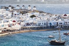 panoramic view of the Mykonos town harbor with famous windmills from the above hills on a sunny summer day, Mykonos, Cyclades, stock photography