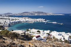 panoramic view of the Mykonos town harbor with famous windmills from the above hills on a sunny summer day, Mykonos, Cyclades, royalty free stock photos