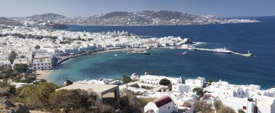 panoramic view of the Mykonos town harbor with famous windmills from the above hills on a sunny summer day, Mykonos, Cyclades, stock images