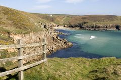 Panoramic View of Nanjizel or Mill Bay near Lands End, Cornwall. Panoramic view of Nanjizel or Mill Bay showing the South West Coastal footpath, view across the Royalty Free Stock Images