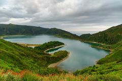 Panoramic view of natural landscape in the Azores, wonderful island of Portugal. Beautiful lagoons in volcanic craters and green f. Ields. Tourist attraction and stock photography