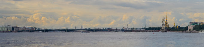 Panoramic view of Neva river in summer. Golden clouds. Saint Petersburg, Russia.  Stock Images